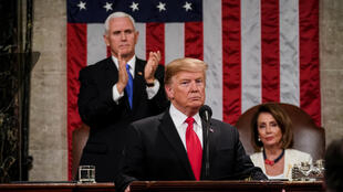 United States President Donald Trump before Vice President Mike Pence and House Speaker Nancy Pelosi during the annual State of the Union address, 5 February 2019.