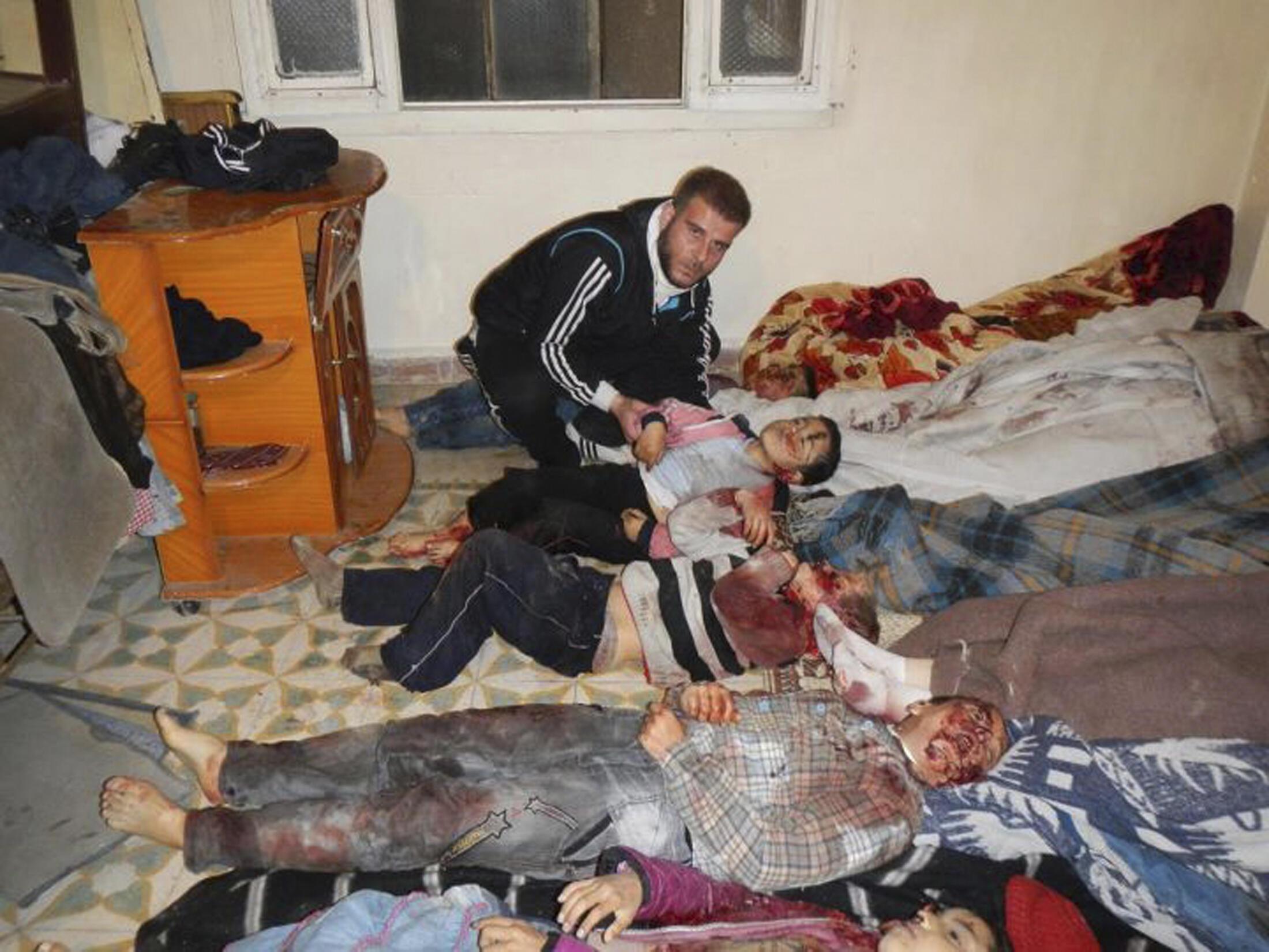 Hotunan gawawwakin wadanda suka mutu a rikicin kasar Syria.