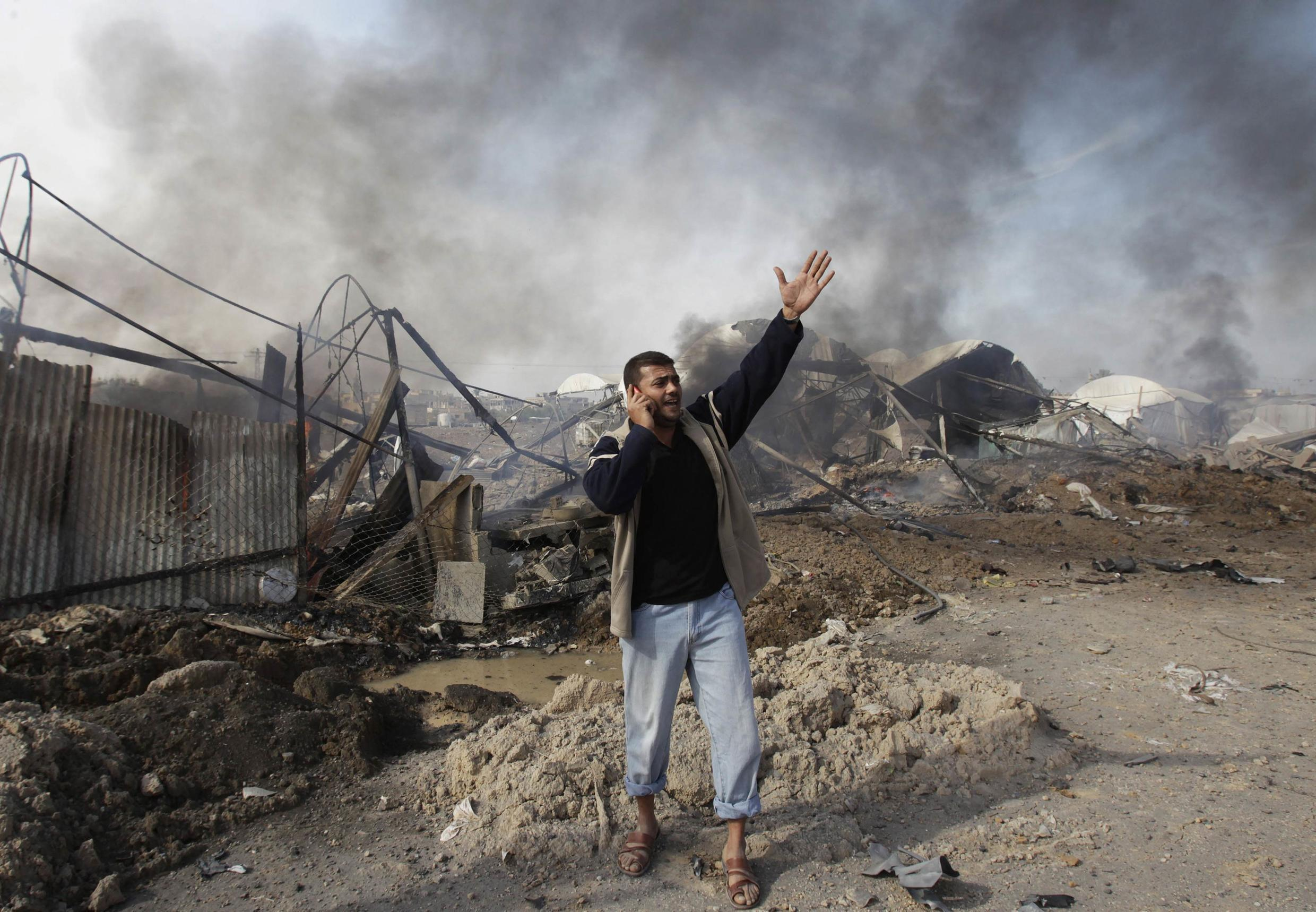 A Palestinian shouts in front of destroyed tunnels after an Israeli air strike in the border of southern Gaza Strip, 21 November, 2012