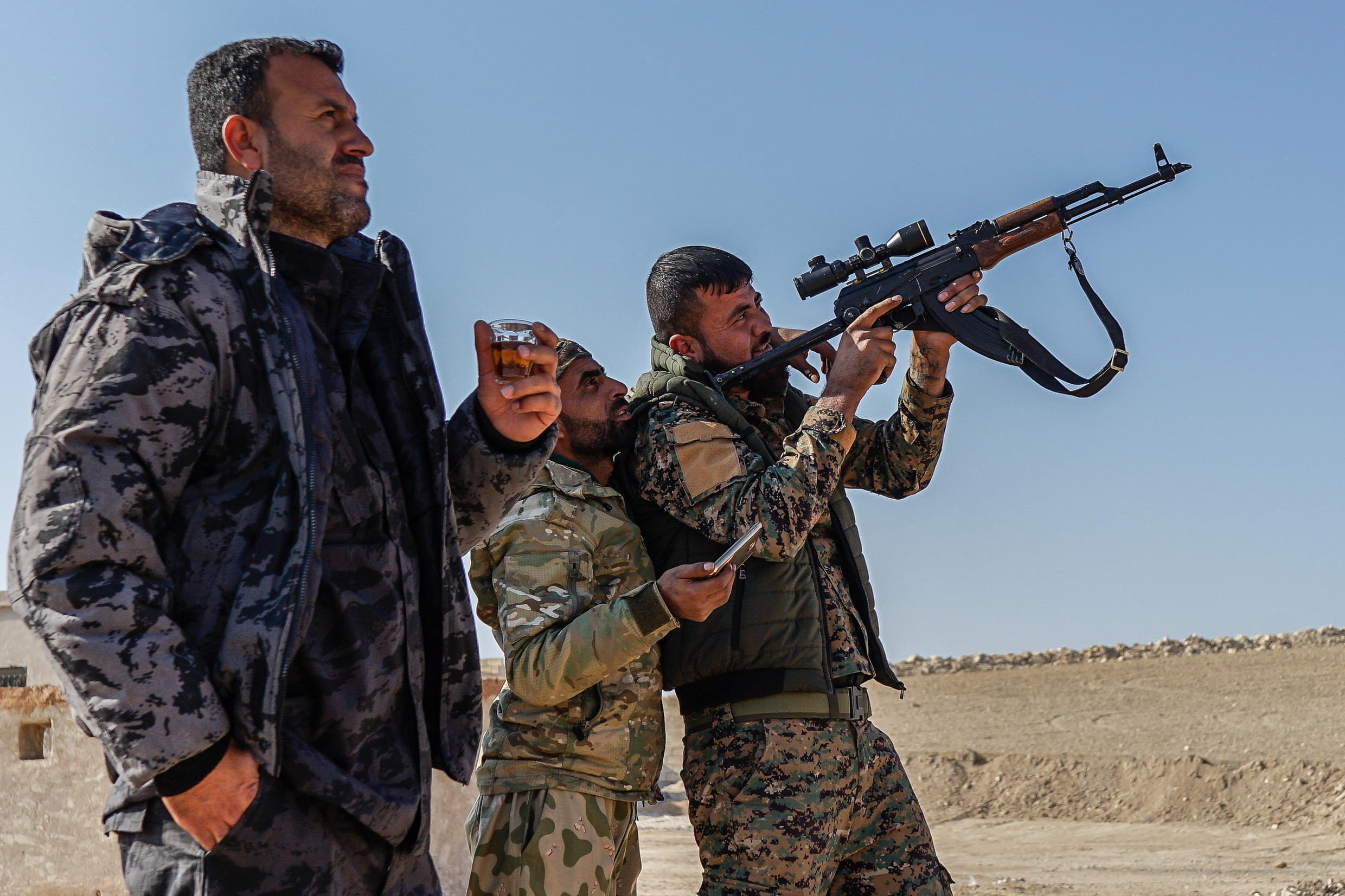 A Syrian Democratic Forces field commander with fighters in northern Syria