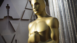 The Academy -- seen as the apex body of the Hollywood film industry -- eased eligibility rules for the Oscars, allowing movies that skip the big screen to contend