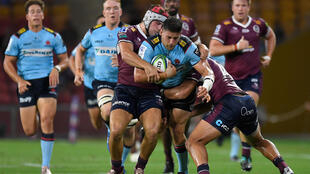 David Porecki of the Waratahs is tackled during the Super Rugby match between the Queensland Reds and NSW Waratahs at Suncorp Stadium in Brisbane on Friday