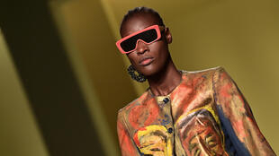 "A model presents a creation by Senegalese fashion designer, Pape Mocodou Fall, aka Mokodu from the collective ""Black Lives Matter in Italian Fashion"" in Milan during the filming of the fashion show that opened the Milan Fashion Week on  Wednesday."