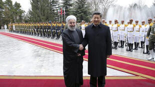 中國國家主席習近平與伊朗總統魯哈尼資料圖片