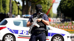 A masked French policeman on duty