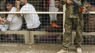 Un groupe de prisonniers détenus au centre de détention d'Al-Rusafa à Bagdad, le 29 avril 2010 (image d'illustration).