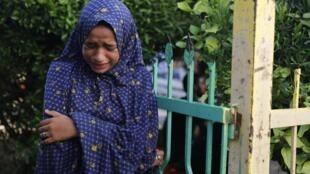 Jovem palestina que perdeu cinco pessoas de sua família durante a ofensiva de Israel em 30 de julho de 2014.