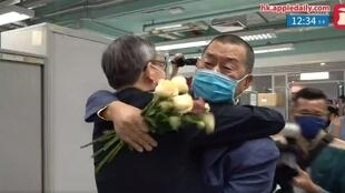 jimmy lai back to his office in the apple daily