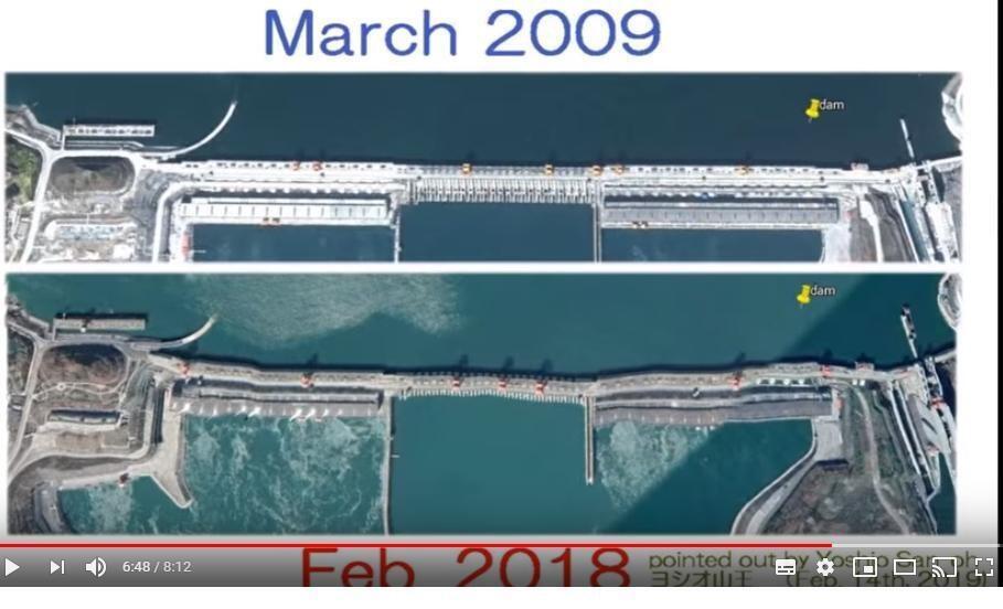 網傳谷歌地球APP顯示的不同年度形狀迥異的三峽大壩圖片