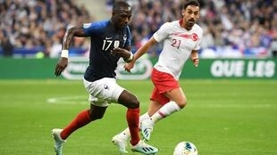 france's midfielder Moussa Sissoko (L) vies with Turkey's midfielder Irfan Kahveci during the Euro 2020 Group H qualification football match between France and Turkey at the Stade de France in Saint-Denis, outside Paris on October 14, 2019.