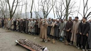 Kashmiri villagers offer funeral prayers for Manzoor Magray at Chogal village