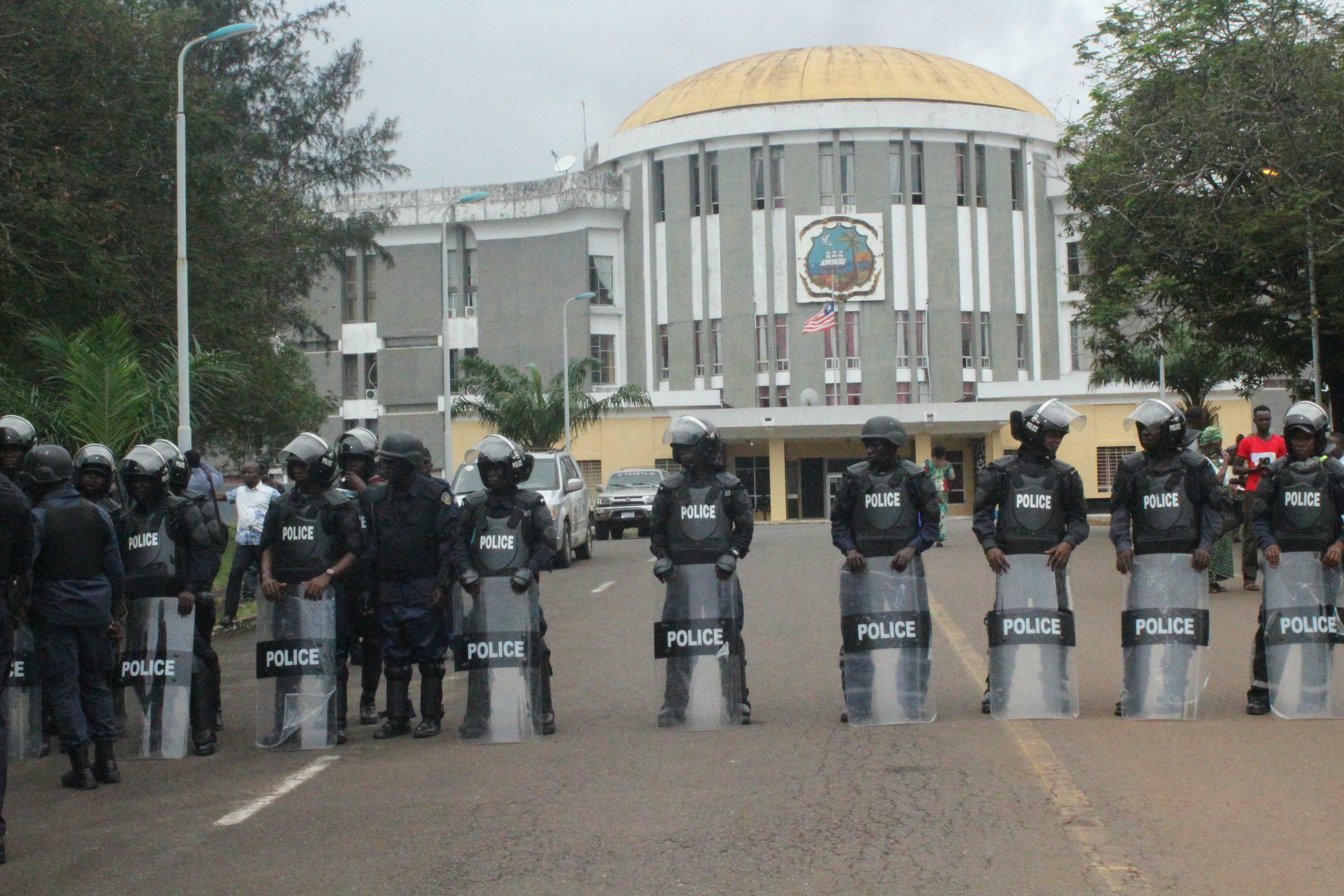 Liberian police block government buildings from the anti-rape protesters on the streets of Monrovia who want to give their petition to President George Weah.