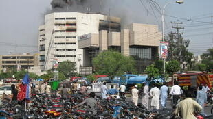 Flames billow out of the Lahore Development Authority offices
