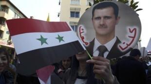 Partidários de Bachar al-Assad, em Damasco.