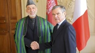 Afghan President Hamid Karzai meets National Assembly Speaker Bernard Accoyer on Friday