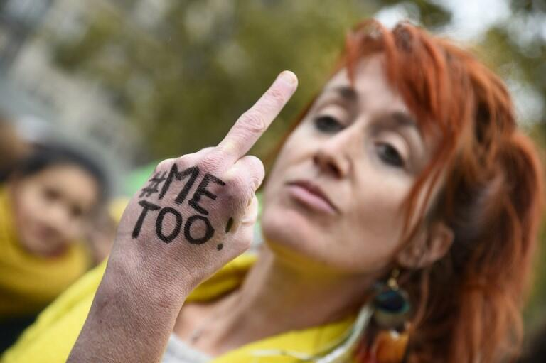 A protester on Sunday's demonstration against sexual assault in Paris
