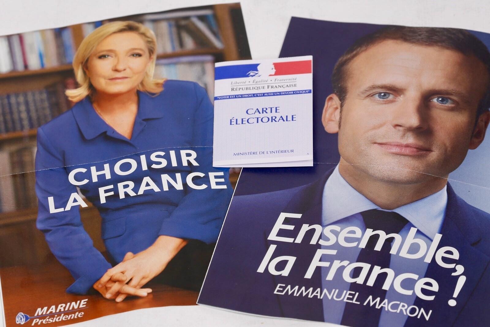 Ứng viên tổng thống Pháp 2017, bà Marine Le Pen (trái) và ông Emmanuel Macron (phải)