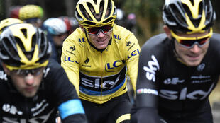 Christopher Froome (C) riding in the 2015 Tour de France