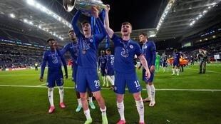 Chelsea's Germany stars Kai Havertz (L front) and Timo Werner (R front) celebrate winning the Champions League final last Saturday