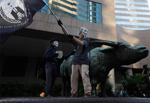 Protesters wearing Guy Fawkes masks made popular by the graphic novel V for Vendetta take part in the Occupy Central protest