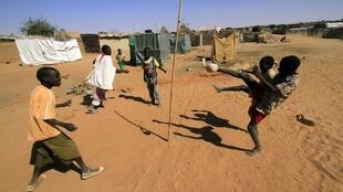Internally displaced children play at the Abu Shouk camp near El Fasher, capital city of North Darfur