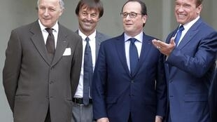 """Visionator"" Arnold Schwarzenegger (R-L) with French President François Hollande, his ecology adviser Nicolas Hulot and France's Foreign Minister, Laurent Fabius on Friday in Paris."