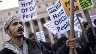 A man protests during a rally against the New York police in New York