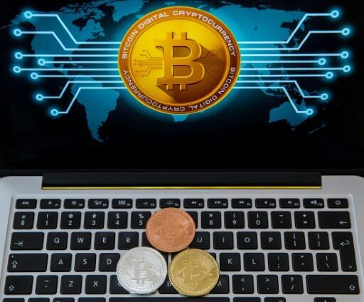 Facebook has eased a ban on cryptocurrencies like bitcoin but will keep in place its prohibition on coin offerings
