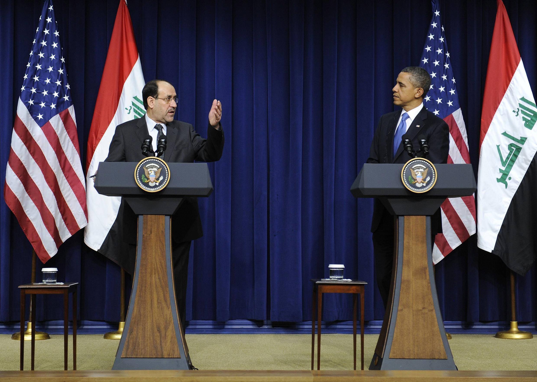 Rais wa Marekani Barack Obama akiwa na Waziri Mkuu wa Iraq Nouri Al Maliki kwenye mkutano wa wanahabari