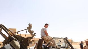 Des membres des forces pro-gouvernementales libyennes, le 18 mai, à Abou Greïn.