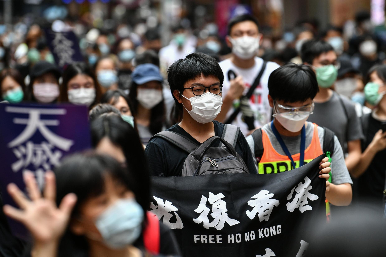 Des manifestants, lors d'un rassemblement pro-démocratie contre un projet de loi sécuritaire de Pékin, à Hong Kong, le 24 mai 2020.
