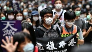 Des manifestants, lors d'un rassemblement pro-démocratie contre le projet de loi sur la sécurité nationale de Pékin, à Hong Kong le 24 mai 2020.