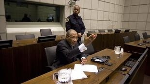 Former Liberian President Charles Taylor (bottom) awaits the start of the prosecution's closing arguments