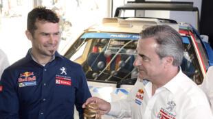 Cyril Despres (G) et Carlos Sainz seront présents sur le Dakar 2015 avec l'écurie Peugeot.