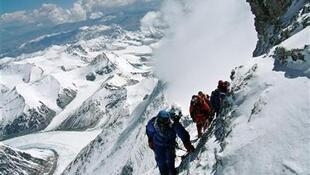Japanese mountaineer Takako Arayama, 70, leads other climbers on the way to the top of Mount Everest May 17, 2006.