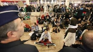Demonstrators sit as around 100 pro-Palestinian activists stage a protest at Brussels national airport in Zaventem