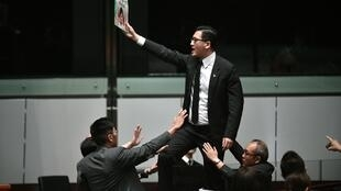 Pro-democracy lawmaker Lam Cheuk-ting was detained in a raid early Wednesday morning
