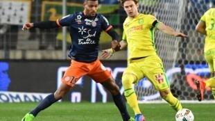 Le Franco-béninois Steve Mounié (à g.) lors du match Nantes-Montpellier remporté par les Canaris le 11 mars 2017.