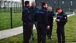 Prison guards at Alencon, in Conde-sur-Sarthe, speak through a fence with colleagues blocking the entrance, 6 March, 2019