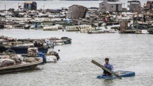 Thiên tai, một nguyên nhân dẫn đến thiếu ăn. Một cảnh tượng ở Quảng Đông, Trung Quốc do cơn bão Rammasun. Ảnh ngày 19/07/2014.