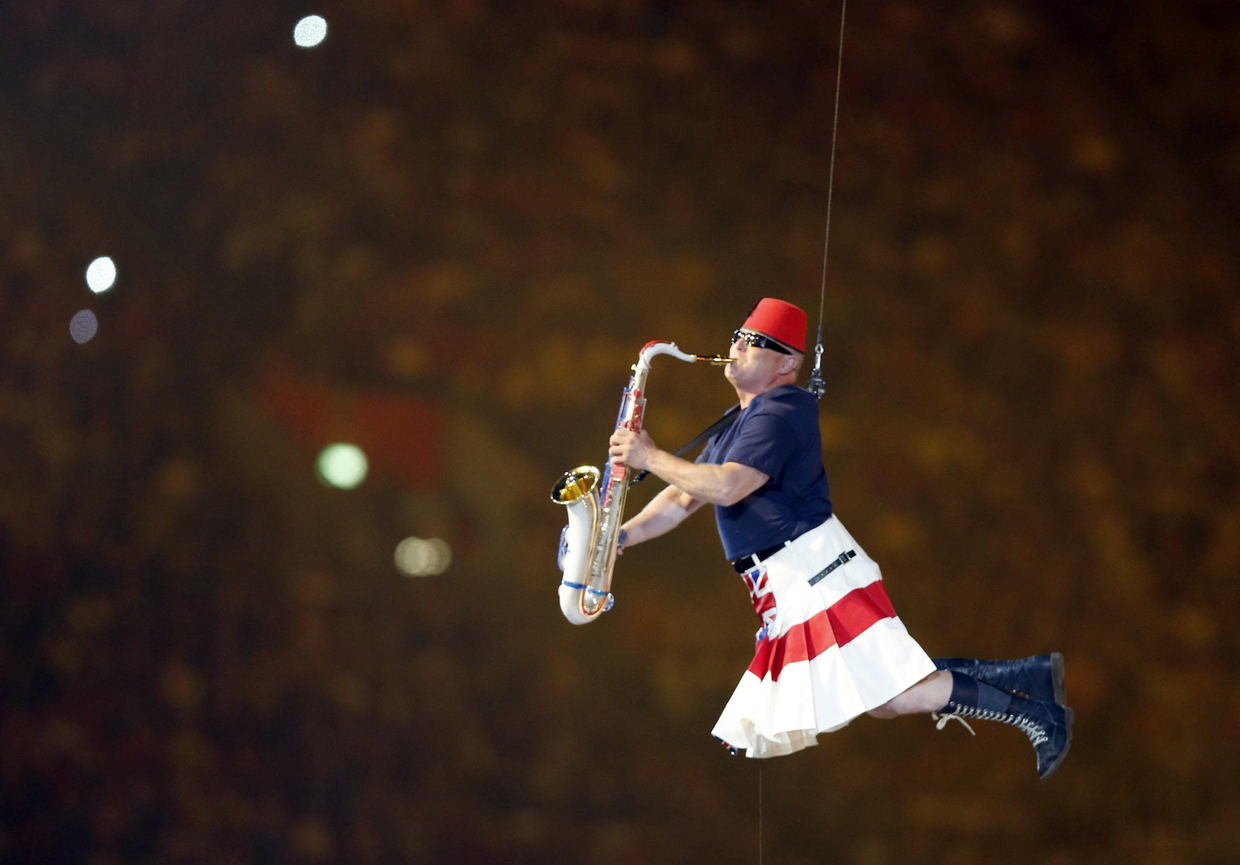 A member of the Pet Shop Boys plays a saxophone during the closing ceremony of the London