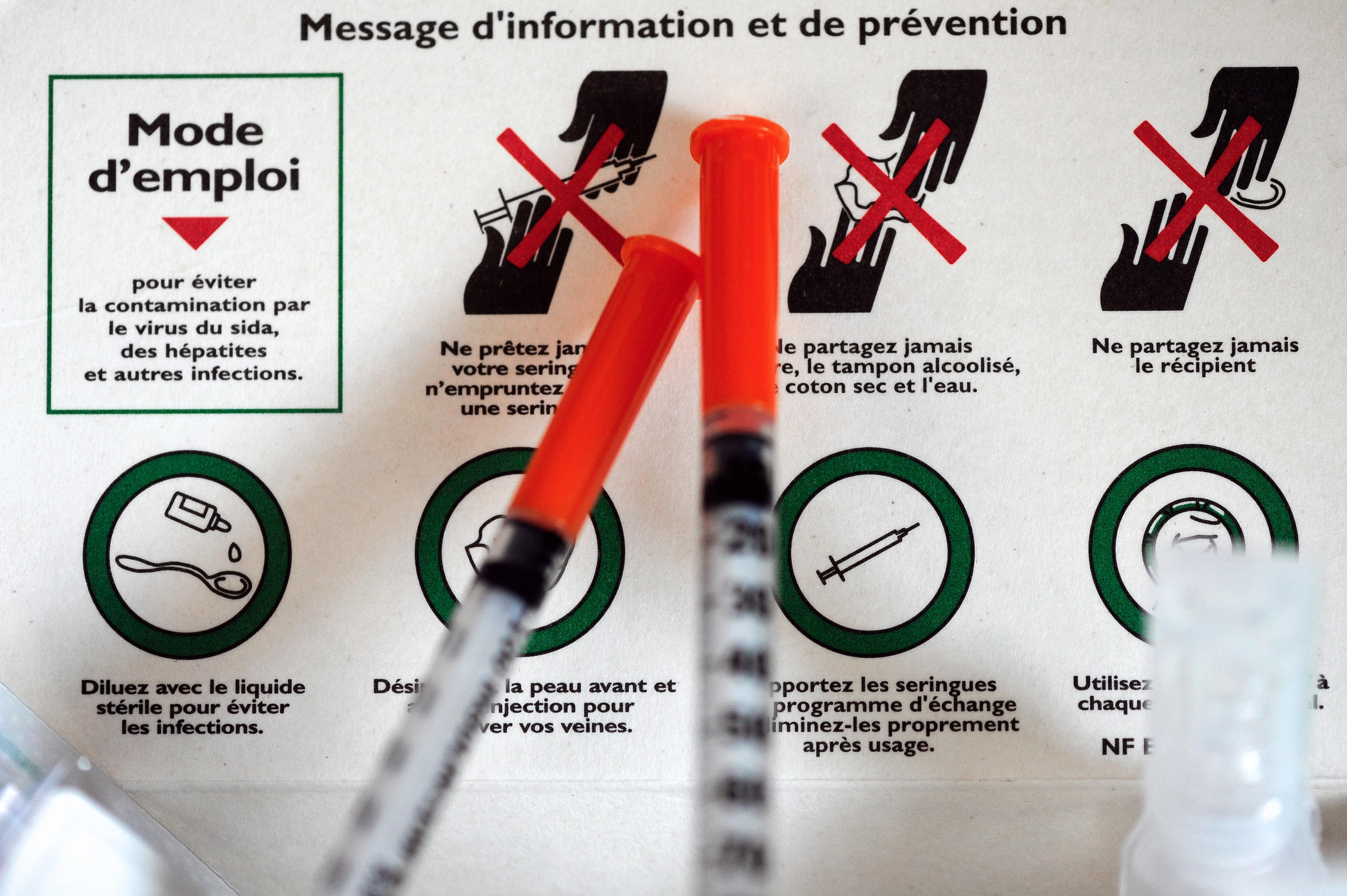 A photo taken on April 29, 2013 in Paris shows a kit containing materials to inject drugs distributed by the Gaia association.