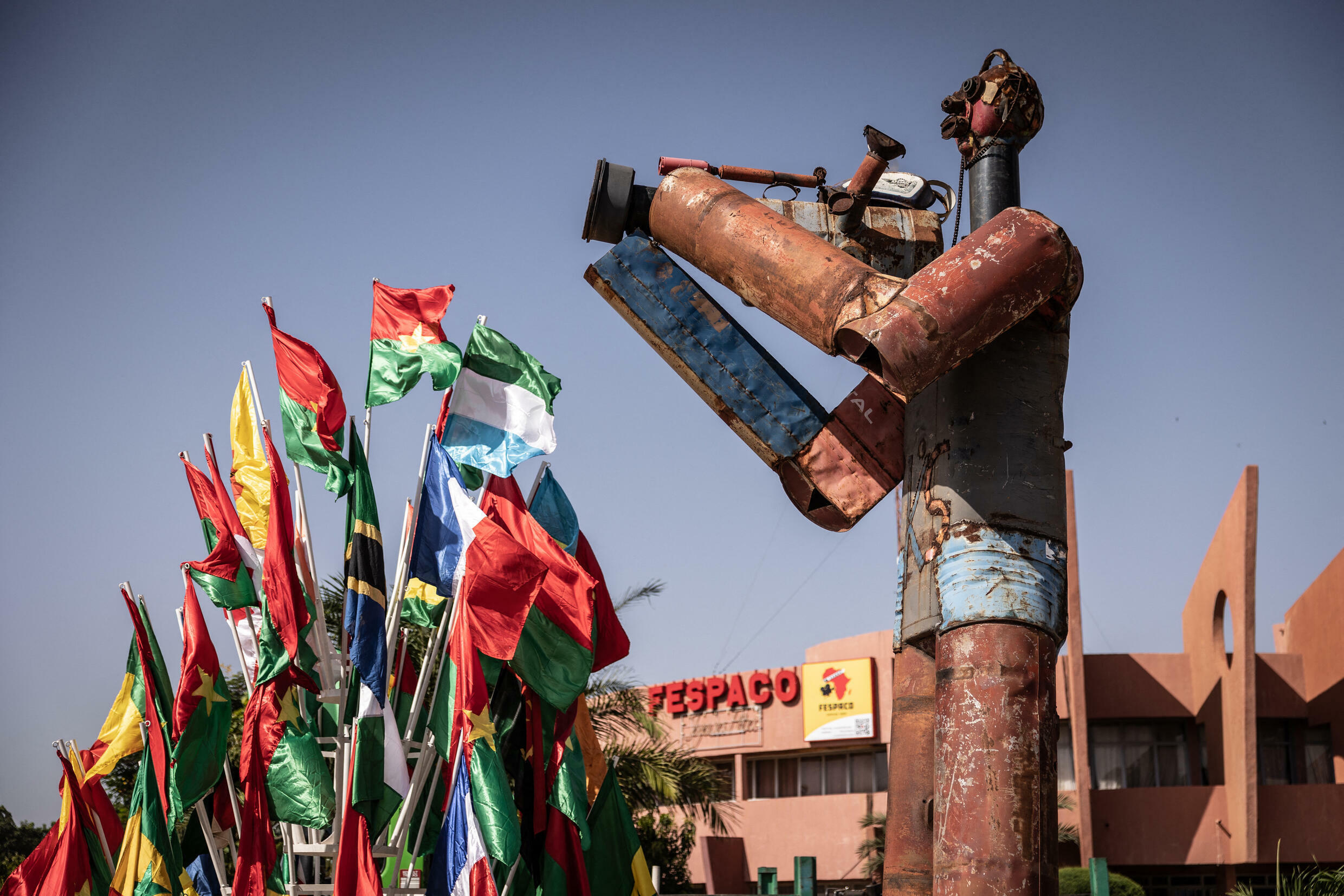 statue of a cameraman stands at the Pan-African Film and Television Festival (FESPACO) headquarters in Ouagadougou, on October 14, 2021. Africa's biggest film festival kicks off on October 16, 2021 in Burkina Faso's capital Ouagadougou, delayed eight months by the Covid-19 pandemic and overshadowed by a brutal six-year-old jihadist insurgency. Seventeen feature-length works are in the main competition for the Pan-African Film and Television Festival of Ouagadougou (FESPACO), the biggest date in the continent's cinema and TV industry. OLYMPIA DE MAISMONT / AFP