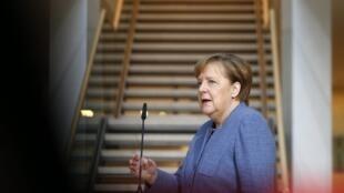 Thủ tướng Đức Angela Merkel đến trụ sở đảng Xã Hội Dân Chủ SPD tại Berlin, ngày 4/02/2018.