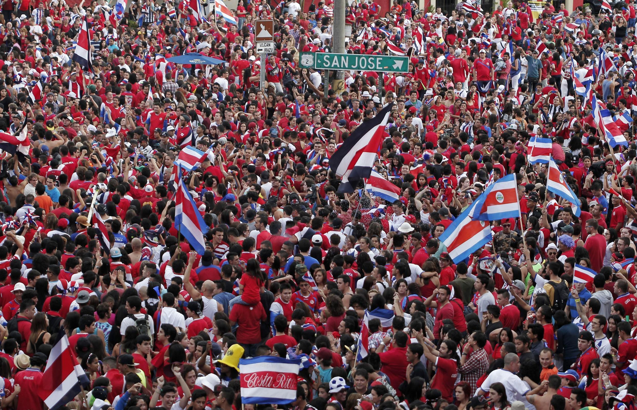 Thousands of Costa Rican fans celebrate their team defeat of Greece, 29 June 2014.
