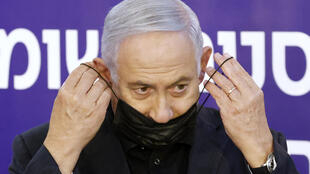 Israeli Prime Minister Benjamin Netanyahu puts on his protective face mask after receiving a coronavirus vaccine at the Sheba Medical Center in Ramat Gan near the coastal city of Tel Aviv on December 19, 2020