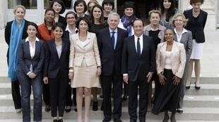 Francois Hollande (2ndR) and Jean-Marc Ayrault (3rdR)  with somen ministers after the government was sworn in