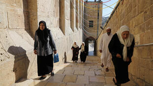Palestinians walk outside al-Ibrahimi mosque, which Jews call the Tomb of the Patriarchs, in the West Bank city of Hebron July 7, 2017.