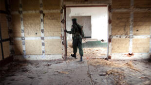 A Congolese soldier walks through the lobby of an abandoned luxury hotel in Eastern DRC