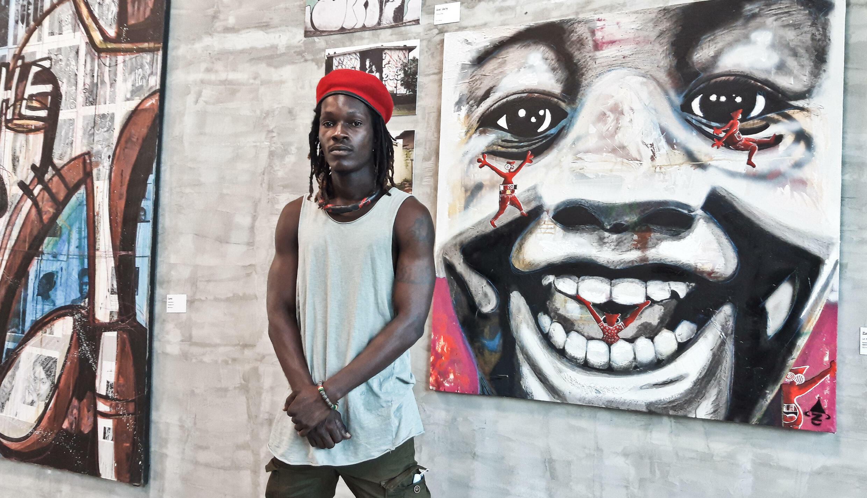 L'artiste Zoro Zipa au musée d'Abobo qui accueille une exposition sur le street art d'Abidjan, en Côte d'Ivoire, le 17 juillet 2021.
